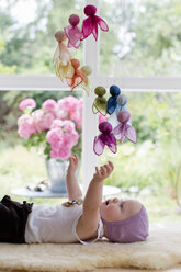 Baby girl playing with mobile - CUF36762