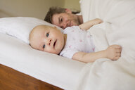 Father and baby daughter on bed - CUF36789