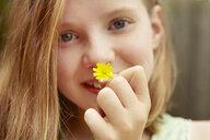 Close up portrait of girl holding dandelion flower - CUF36915