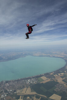 Female skydiver free falling above Siofok, Somogy, Hungary - CUF37065