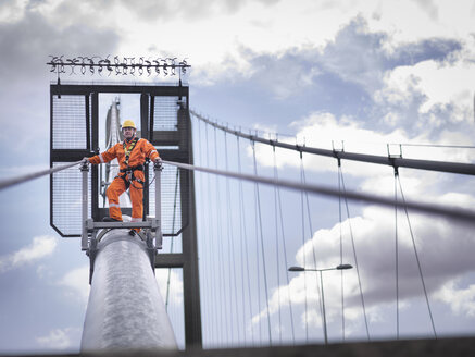 Bridge worker on cable of suspension bridge. The Humber Bridge, UK was built in 1981 and at the time was the world's largest single-span suspension bridge - CUF37215