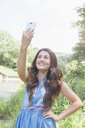 Young woman taking selfie - CUF37353
