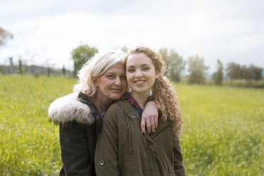 Portrait of mother and teenage daughter in field - CUF37701