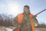 Mid adult man holding shotgun in Petersburg State Game Area, Michigan, USA - ISF14596