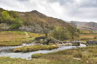 United Kingdom, England, Cumbria, Lake District, Stone bridge over river Brathay - WPEF00540