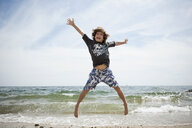 Informal portrait of jumping boy on beach at Falmouth, Massachusetts, USA - ISF14648