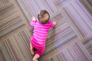 Toddler girl crawling on floor, overhead view - ISF14824