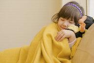 Young girl lying on sofa pretending to sleep - ISF15112