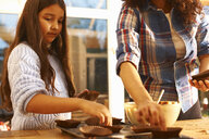 Mother and daughter baking in kitchen - CUF38021