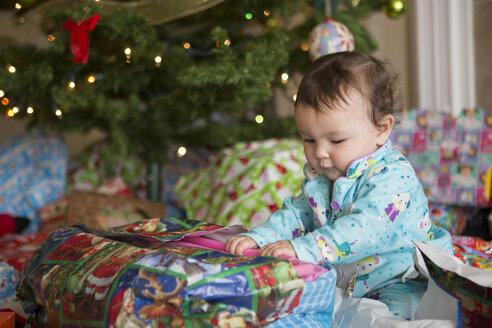 Baby girl opening presents on her first Christmas - ISF15172