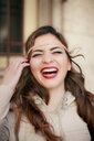 Portrait of young woman laughing - ISF15271