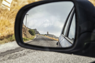 Greece, Peloponnese, village with typical tower house, mirrored in wing mirror - MAMF00130