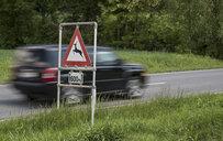 Austria, Burgenland, car and traffic sign deer crossing sign - EJWF00887