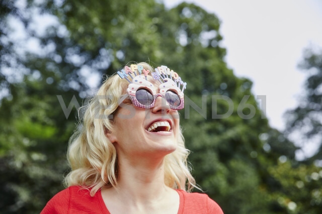 Happy woman wearing birthday eyeglasses - RHF02046