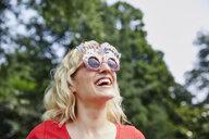 Happy woman wearing birthday eyeglasses - RHF02046