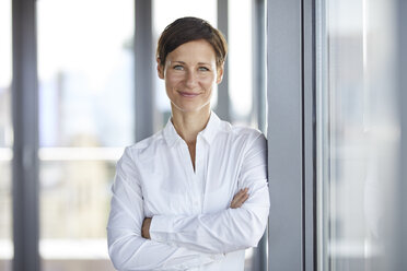 Portrait of smiling businesswoman in office - RBF06354