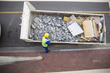 South Africa, Cape Town, South Africa, Builder looking at rubble - ZEF15767