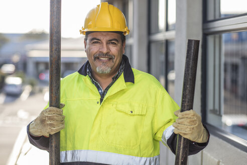 South Africa, Cape Town, Builder holding pipes - ZEF15770