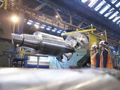 Steel roller on lathe in engineering factory - CUF38294
