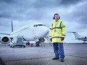 Airport worker on runway, portrait - CUF38327