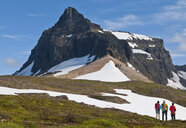 Hikers looking out over Dyrfjoll Mountain range, East Iceland, Iceland - CUF38591