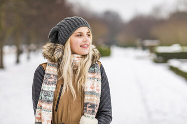 Portrait of smiling teenage girl in winter - WPEF00572