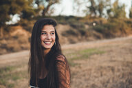 Portrait of laughing teenage girl in nature - ACPF00069