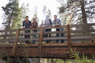 Portrait of five young adult friends on wooden bridge in forest, Los Angeles, California, USA - ISF15897