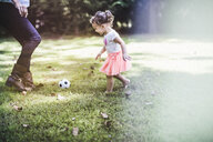 Baby girl playing ball in garden - ISF16062