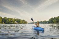 Young woman kayaking on river, Cary, North Carolina, USA - ISF16218