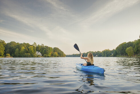 Young woman kayaking on river, Cary, North Carolina, USA - ISF16218