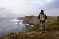 Mid adult man standing on The Cliffs of Moher, The Burren, County Clare, Ireland - ISF16290