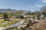 View of Epupa Falls and distant mountains, Namibia - CUF38958