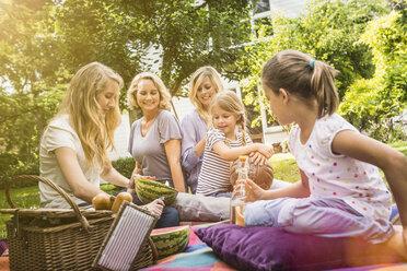 Three generation of women having picnic - CUF39122