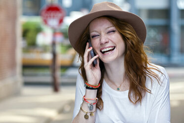 Portrait of young woman using mobile phone - ISF16512