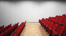 Red chairs in empty auditorium - CUF39566