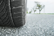 Car tire on road, close up - CUF39581