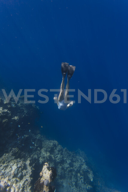 Indonesia, Bali, young woman snorkeling - KNTF01138