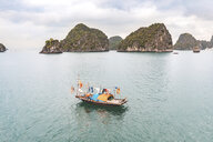 Vietnam, Ha Long bay, with limestone islands and small boat - WPEF00642