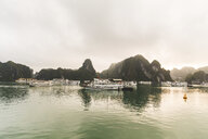 Vietnam, Ha Long bay, with limestone islands and tourboats - WPEF00645