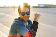 Happy man with sunglasses, portrait - AFVF00671