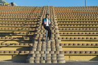 Man sliding on railing of a grandstand - AFVF00680
