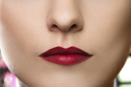 Cropped studio portrait of young woman's lips - CUF39802