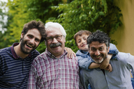 Three generations of male family together - CUF39841