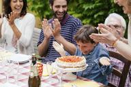 Boy being surprised with birthday cake - CUF39862