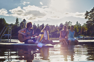 Two young couples relaxing on pier, Gavle, Sweden - CUF39871