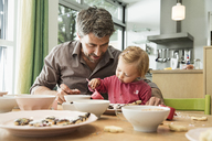 Father and daughter baking in kitchen - CUF39919