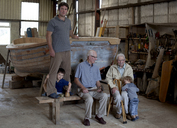 Group portrait of four generations of male boat builders - CUF40017