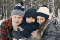 Portrait of friends embracing at park during winter - MASF08133