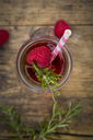 Glass bottle of homemade raspberry lemonade flavoured with rosemary - LVF07238